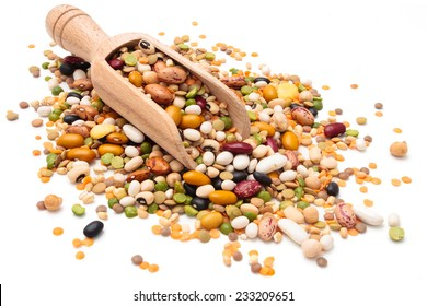 Assorted legumes in wooden scoop. Isolated on white background.