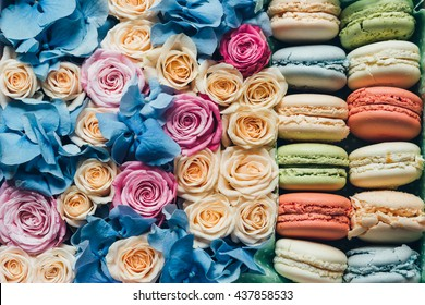 Assorted macaroon and flowers in a box, a flat top view