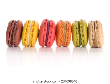 Assorted macaroons. Flavors from left to right: chocolate, lemon, raspberry, salted caramel, matcha, and earl gray tea