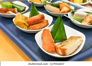 Assorted Malaysia Nyonya kuih kueh served on serving plate on tray