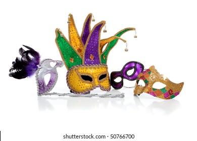 Assorted mardi gra masks including gold, purple and green on a white background