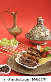 Assorted meat satay dish served in a Mediterranean setting