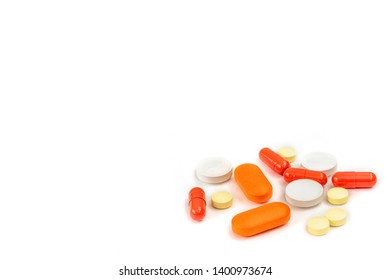 Assorted medical pills, capsule, medication, tablets isolated on white with copy space. Pharmacy lab and pharmaceutical research concept.