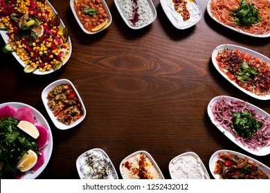 Assorted Middle Eastern halal dishes set and mezes background. Empty in the middle of the photo. Turkish and Arabic kitchen foods top view photo.