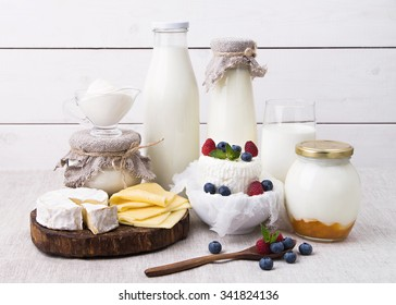 Assorted milk products for breakfast and healthy life - milk, yogurt, cheese, Camembert, home made cream cheese with berries, kefir, sour cream