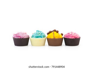 Assorted multicolored cupcakes in a row