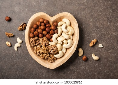 Assorted nuts in heart shaped bowl