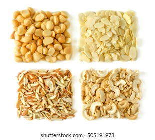 Assorted nuts on white background (from top left: Macadamia, almond sliced, almond sticks, cashew nut), Beautifully arranged.
