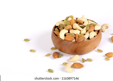 Assorted nuts on white, dry fruits, mix nuts, almond, cashew, raisins