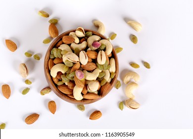 Assorted nuts on white, dry fruits, mix nuts, almond, cashew, pistachio, raisin