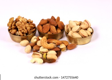 Assorted nuts on white, dry fruits, mix nuts, almond, cashew, pistachio, raisin, walnuts