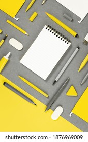 Assorted office and school white yellow and gray stationery . Organized knolling for back to school or education and craft concept. Note pad. Illuminating Banner. Copy space. Mockup banner