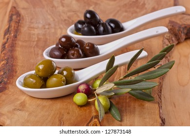 Assorted olives on spoons