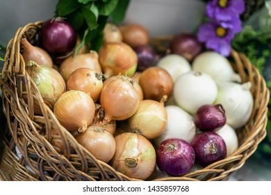 Assorted onions of different varieties. Basket with fresh organic vegetables, Live vitamins, selectiv focus. Farmers market