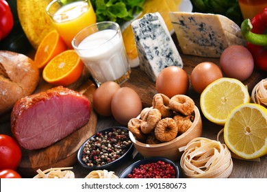 Assorted organic food products on wooden kitchen table.