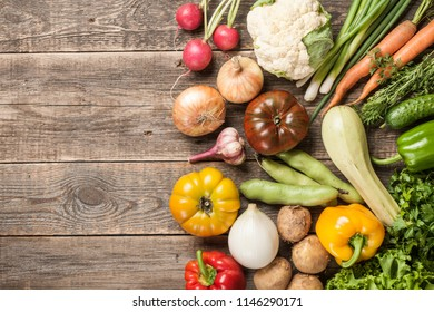 Assorted organic fresh vegetables on wooden table