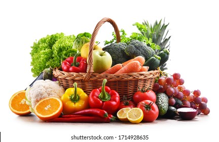 Assorted organic vegetables and fruits in wicker basket isolated on white background. - Shutterstock ID 1714928635