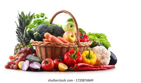 Assorted organic vegetables and fruits in wicker basket isolated on white background. - Shutterstock ID 1720876849