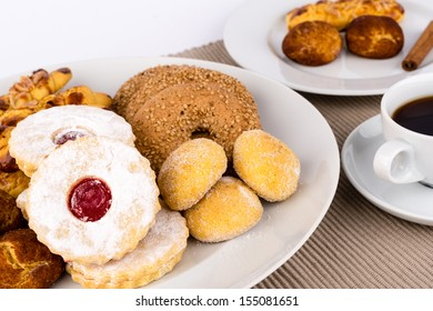 Assorted pastries and a cup of coffee.