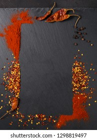 Assorted pepper spices on dark black background. Seasonings for food. Homemade spices ingredients for cooking. Spices frame
