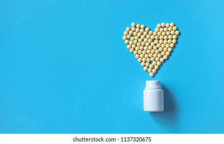 Assorted pharmaceutical medicine pills, tablets and capsules and bottle on purple background. Drugs and various narcotic substances. Copy space for text. Stock photo for design