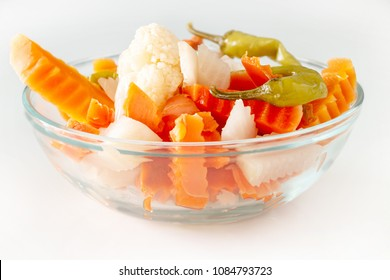 Assorted pickles vegetables carrot, chili, cauliflower in glass bowl. Top view. Isolated. Copy space.