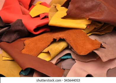 Assorted pieces of skin. Rawhide. Leather pieces. Pieces of colored leather.