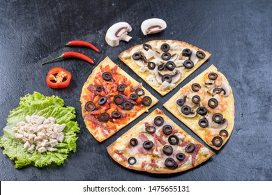 Assorted pizza slices. Margherita, pepperoni, four cheese pizza. Top view. Different types of pizza on the textured old wooden table.