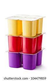 Assorted plastic containers for dairy products with foil lid. Isolated on a white.