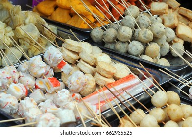 Assorted processed seafood flavored food or surimi on bamboo skewer. Surimi based industry is rapidly growing in Southeast Asia countries.