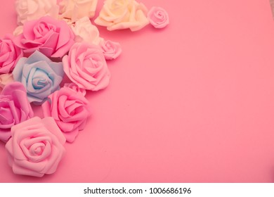 Assorted roses heads. Various soft roses and leaves scattered on a vintage background.