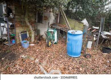 Assorted rubbish in a neglected garden