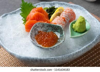 assorted sashimi sushi on shaved ice