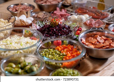 Assorted sausages and vegetables over a table, ready to make fiambre, a traditional festival dish for All Saints Day in Guatemala city.