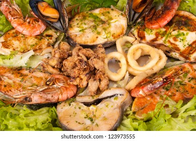 Assorted seafood grilled and served on salad