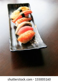 Assorted seafood Sushi on black plate