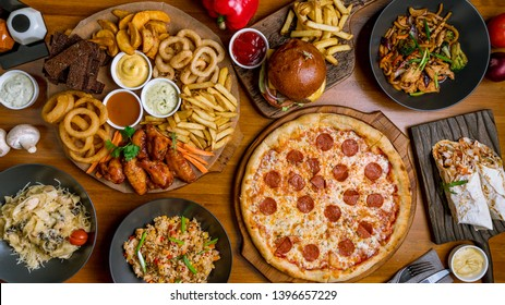 Assorted set from pizza Pepperoni, Assorted beer snacks, burger, wok and rice top view