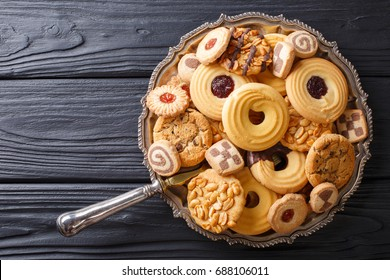 Assorted shortbread cookie close-up on a plate on a table. vertical view from above
