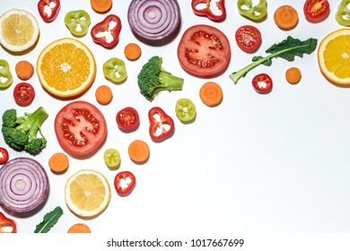 Assorted sliced vegetables and fruits on white background.  Flat lay. Food vegan concept.