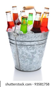 Assorted soda bottles in a metal bucket full of ice. Vertical format over white with reflection