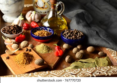 Assorted spices, garlic and olive oil  on a wooden tray