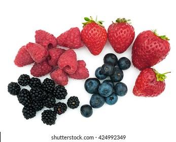 Assorted summer berries - strawberries, blueberries, blackberries.