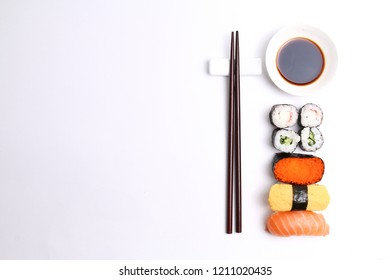 Assorted sushi with chopsticks on white background