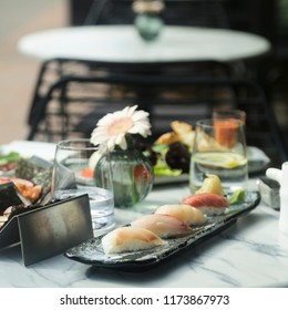 Assorted sushi and rolls, outdoors