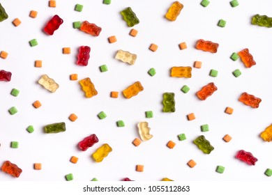 Assorted sweets flat lay background on white.