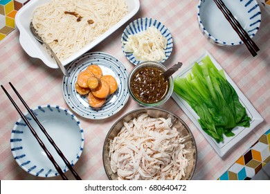 Assorted Taiwanese homecooking food set.Top view.Homemade dinner for family.Boiled vegetables.Sweet potatoes.Bamboo shoot salad.Vermicelli.Shredded chicken.