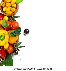 Assorted tomatoes and vegetables isolated on white background. Photo for your design