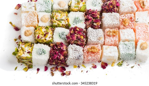 Assorted traditional turkish delight on white background