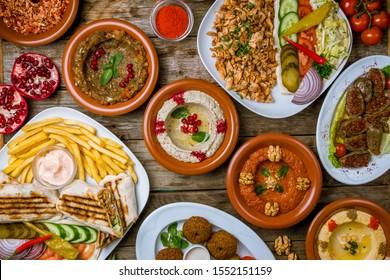 assorted Turkish dishes, hummus, muhamara, mutabal, falafel, shawarma - Shutterstock ID 1552151159