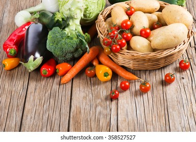 Assorted of useful vegetables on a wooden background